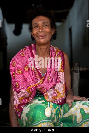 Woman With Colorful Dressing Sitting In Her House, Siyu, Pate Island, Lamu, Kenya - Stock Photo