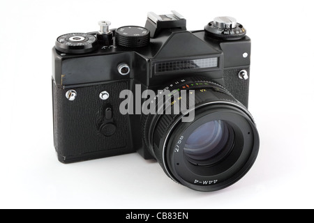 Old 35mm film camera isolated on white - Stock Photo