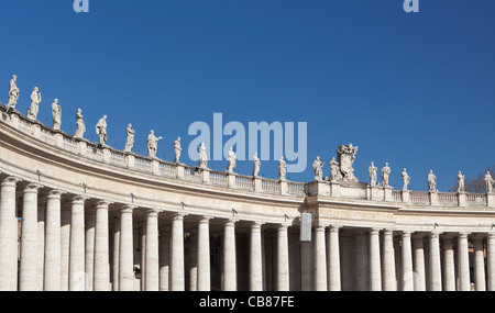 St. Peter's square, colonnade and statues, Vatican City, Rome, Italy - Stock Photo