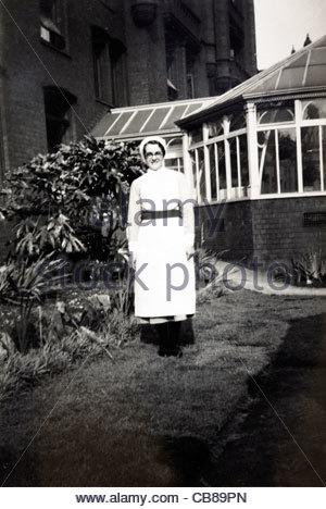 full length portrait of a nurse 1900s England - Stock Photo