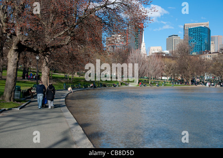 The Boston Common Frog Pond and people walking in springtime - Stock Photo