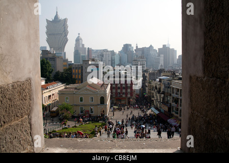 View of the approach to the ruins of St Paul's church, with the Grand Lisboa Casino in the background Macau - Stock Photo