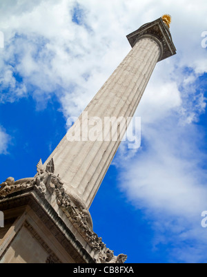 The Monument to the Great Fire of London a stone Roman Doric column in the City of London designed by Sir Christopher - Stock Photo