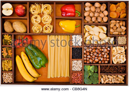 Overhead view of fibre and carbohydrate food in box with wooden separators - Stock Photo