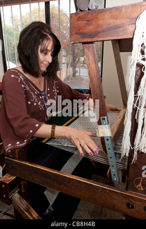 Weaver at work, Trujillo's Weaving Shop, Chimayo, New Mexico. - Stock Photo