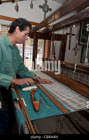 Weaver at work, Trujillo's Weaving Shop, Chimayo, New Mexico. - Stock Photo