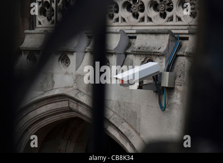 CCTV security camera attached to historic building in London - Stock Photo
