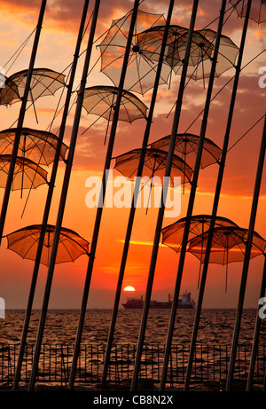 Greece, Thessaloniki.Sunset  at 'The Umbrellas' , an artistic installation, by George Zoggolopoulos. - Stock Photo