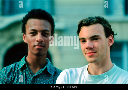 Paris, France, Portrait Two French Male Teens, one African, One Caucasian, on Street (MR) - Stock Photo