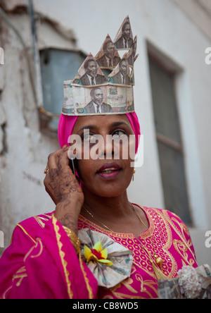 Woman Calling With Cellphone, Wearing Banknotes Hat In Maulidi Festival, Lamu, Kenya - Stock Photo