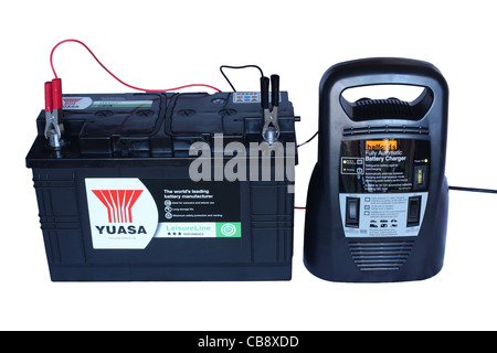 Charging a Yuasa lead acid leisure battery using an automatic deep cycle charger supplied by Halfords  isolated - Stock Photo