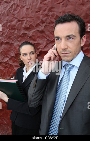 a manager at phone and his assistant - Stock Photo