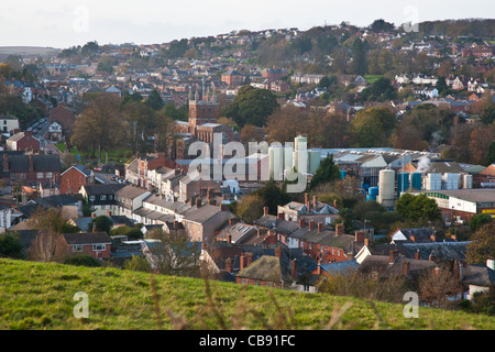 The Mid Devon market town of Crediton, Devon, England showing industry and houses beside the C10th Parish Church - Stock Photo