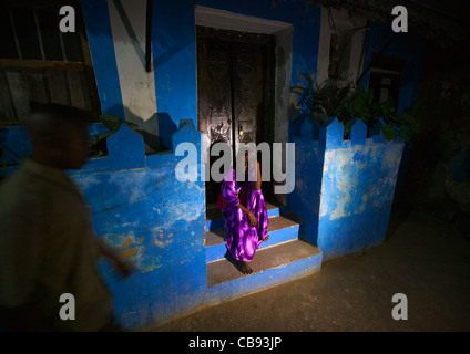 Woman Standing On The Stairway Outside A House, Lamu, Kenya - Stock Photo