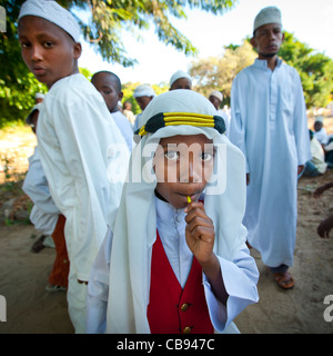 Little Boy Wearing Traditional Dressing In A Maulidi Ceremony, Lamu, Island, Kenya - Stock Photo