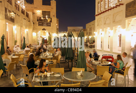 A night scene in one of the restaurant areas in Qatar's Souq Waqif, in central Doha (with some motion blur) - Stock Photo