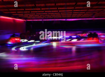 dodgem cars in motion - Stock Photo