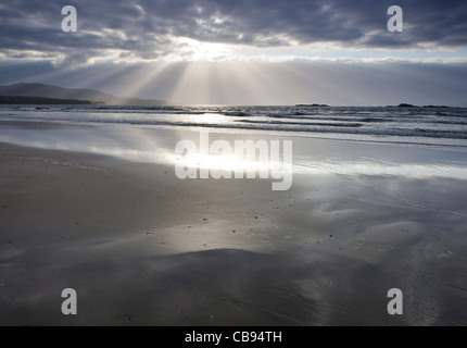 Dramatic Sunset over a remote Irish beach near Lettergesh beach, County Galway Ireland - Stock Photo