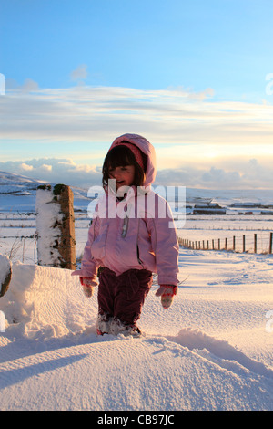 Young girl in snowdrift - Stock Photo