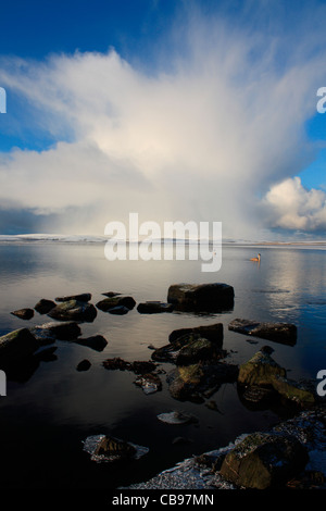 Cumulonimbus cloud over Orkney - Stock Photo