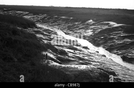 Mouth of river Axe near Uphill, Somerset, England - Stock Photo