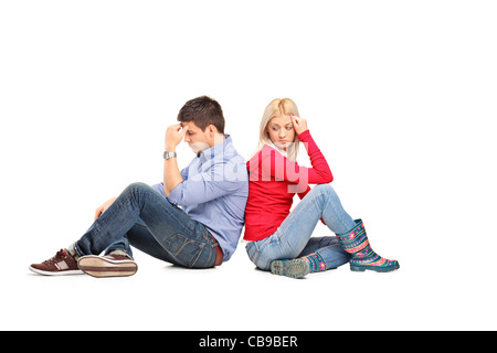 Couple sitting with their backs turned after having an argument - Stock Photo