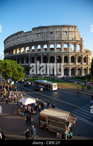 Colosseum in a busy day of traffic - Stock Photo