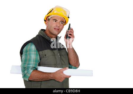 Foreman using radio receiver - Stock Photo