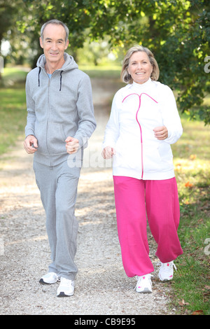 Elderly couple jogging - Stock Photo