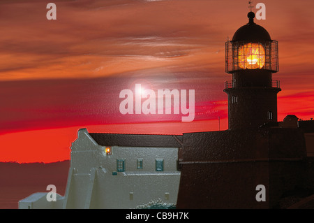 Portugal, Algarve: Sundown at lighthouse Cape Sao Vicente as HDR image with photofilter - Stock Photo