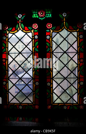 Close-up of a stained glass window in Basilica of Holy Blood in Bruges, Belgium - Stock Photo