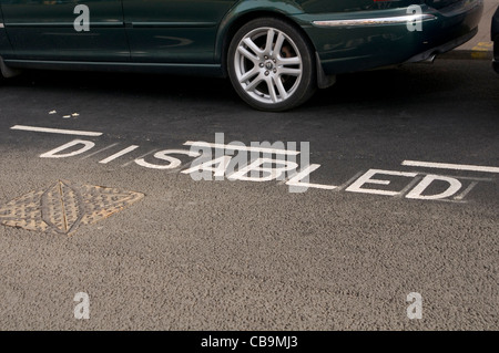 disabled parking bay space car - Stock Photo