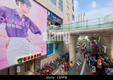 motorbikes and mopeds parked by a mall in Chengdu city centre center Sichuan province PRC, People's Republic of - Stock Photo