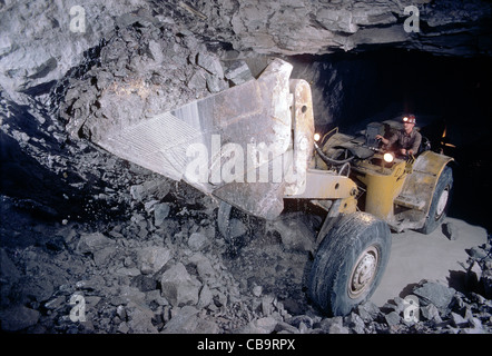Heavy excavating equipment underground in a fluorspar (fluorite) mine, Illinois, USA - Stock Photo