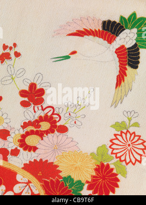 Colorful floral fragment of vintage silk Japanese kimono fabric pattern - Stock Photo