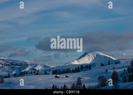 Winter fairy tale with snow covered Settsass mountain as background in ski resort of Alta Badia, Dolomites, Italy. - Stock Photo