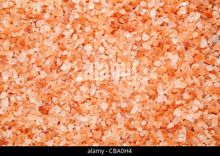 background of Himalayan rock salt - pink and orange coarse crystals - Stock Photo