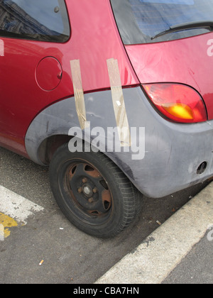 smashed broken rear car door window taped up as a ...