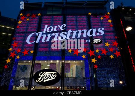 Christmas lights, Boots chemist, Oxford Street, London, England, UK - Stock Photo
