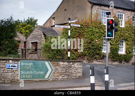 Road sign showing distances in miles and furlongs, Kirkby Stephen, Cumbria, England - Stock Photo