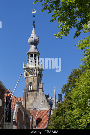 The spire of Grote Kerk, the Big Church, in the town of Veere, Zeeland, The Netherlands - Stock Photo