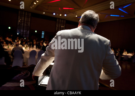 Master of ceremonies, MC, compere,  at an evening function, Japan. - Stock Photo