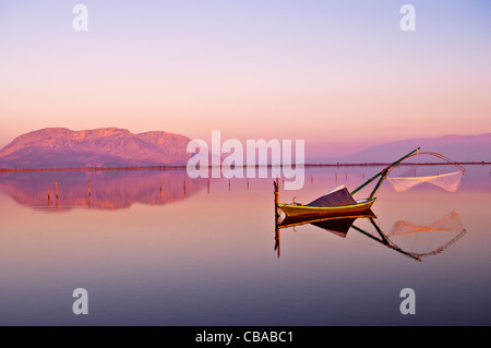 Traditional wooden fishing boat in the lagoon of Messolonghi, Greece - Stock Photo