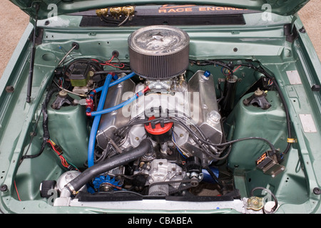 High powered Ford V8 engine in a drag racing car - Stock Photo