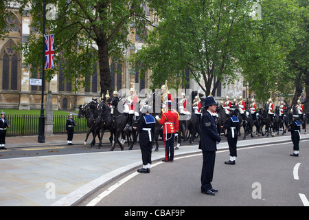 Household Cavalry Mounted Regiment Horse Guards outside Westminster Abbey, British Royal Navy Metropolitan Police - Stock Photo