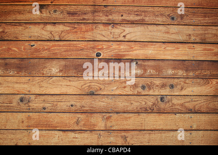 wood board wall with knotty wooden planks - Stock Photo