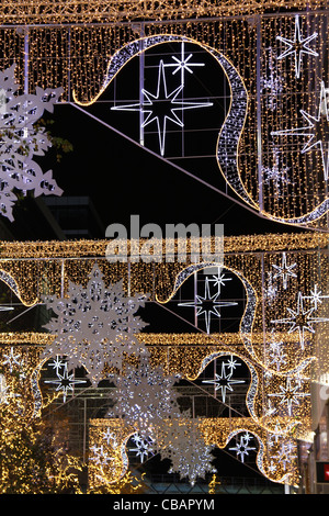 Outside Westfield Shopping Centre, Stratford, beautiful Christmas decorations of stars and snowflakes. - Stock Photo