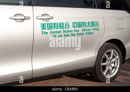 A car with a funny advertising slogan to promote the China Solar Valley. Dezhou, Shandong, China - Stock Photo