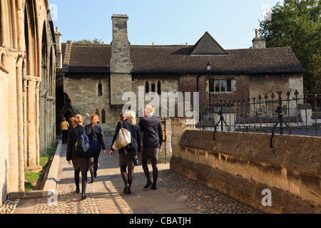 Pupils from The King's School by Infirmary arches and 14th century Dulverton House 6th form centre in Gloucester - Stock Photo