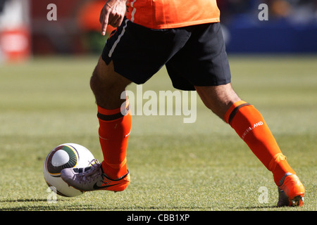 A Dutch player controls the ball during a 2010 FIFA World Cup match against Denmark at Soccer City Stadium on June - Stock Photo